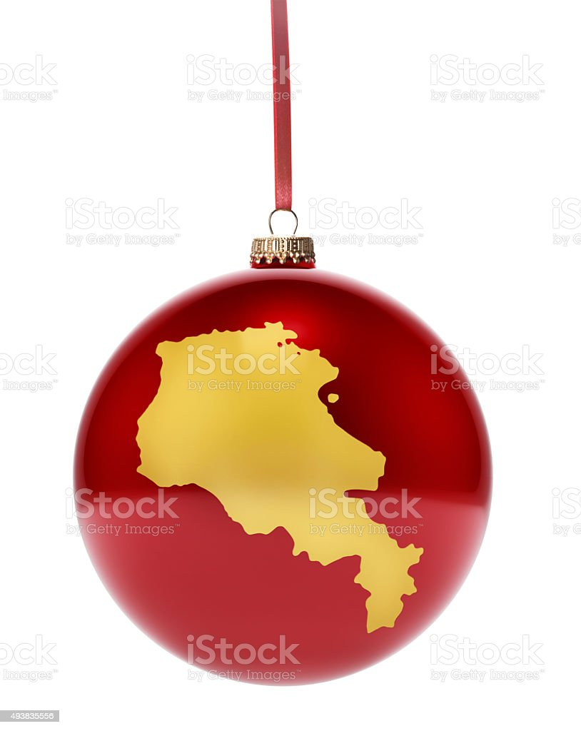 Red bauble with the golden shape of Armenia.(series) stock photo