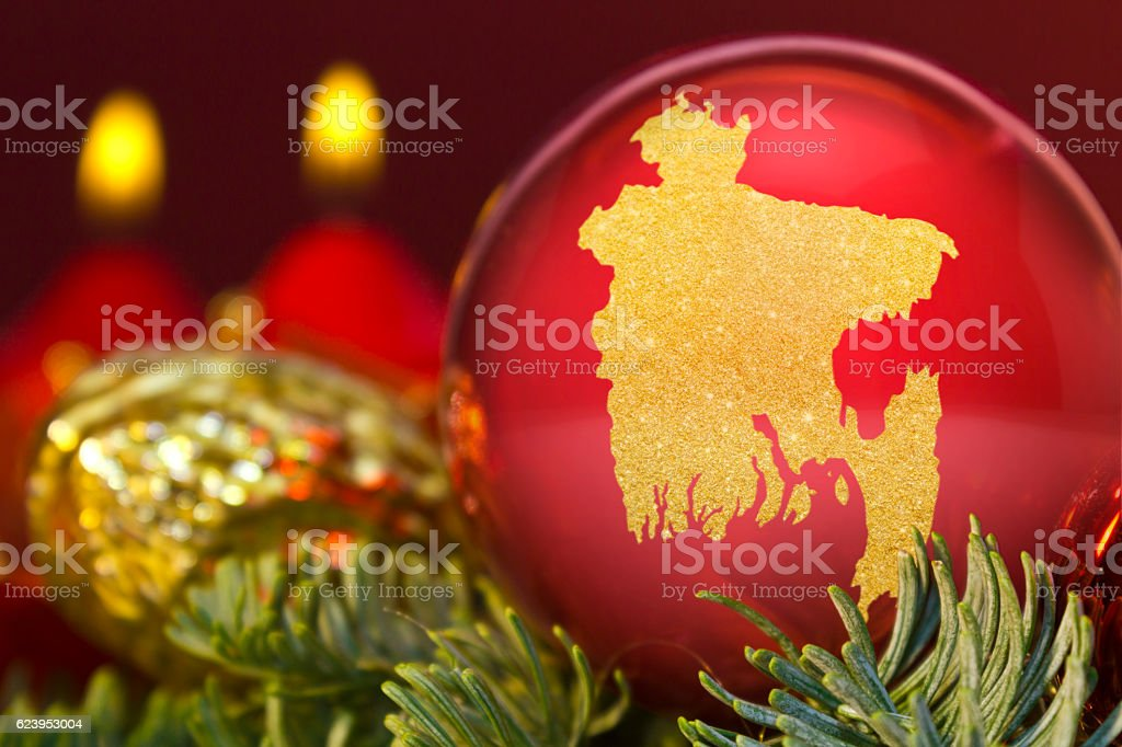 Red bauble with the golden shape of Bangladesh.(series) stock photo