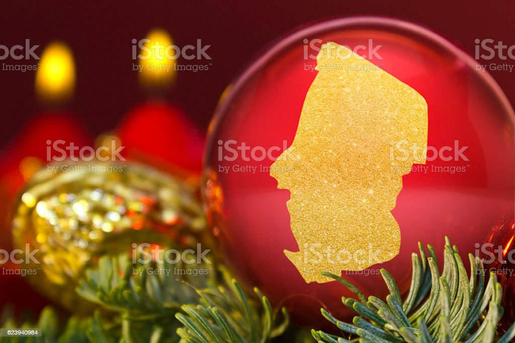 Red bauble with the golden shape of Chad.(series) stock photo