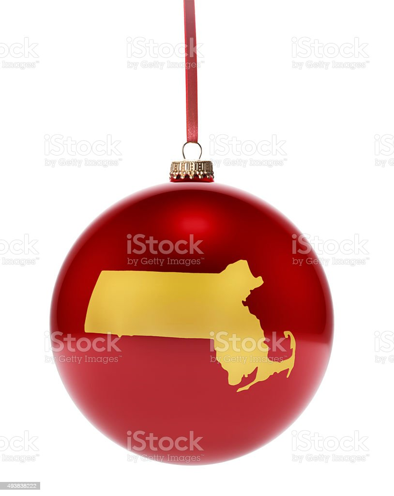 Red bauble with the golden shape of Massachusetts.(series) stock photo