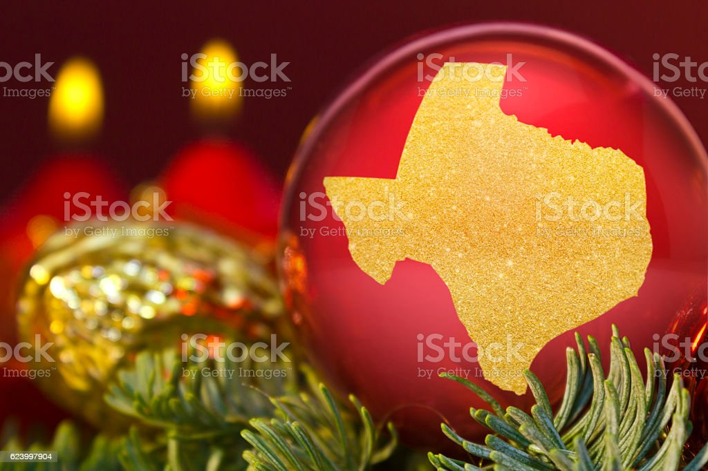Red bauble with the golden shape of Texas.(series) stock photo