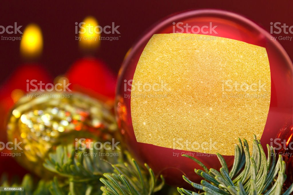 Red bauble with the golden shape of Wyoming.(series) stock photo