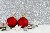 red baubles on glitter background