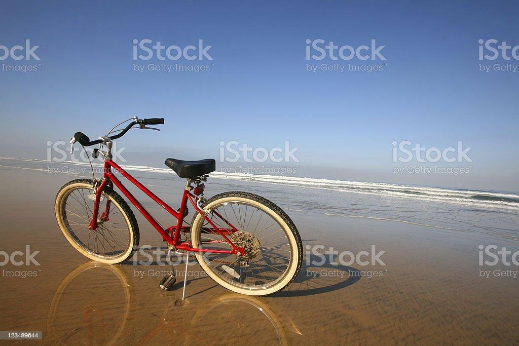 Red Beach Cruiser on the Sand stock photo