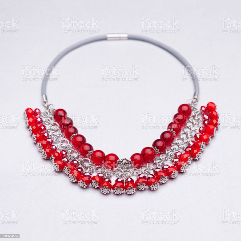 Red beads necklace isolated on white background stock photo