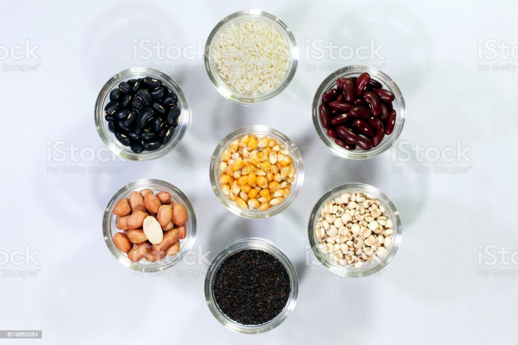 Red beans, black beans, Peanut, pine nut,corn,rice,sesame, millet grains with the health benefits of whole grains. stock photo