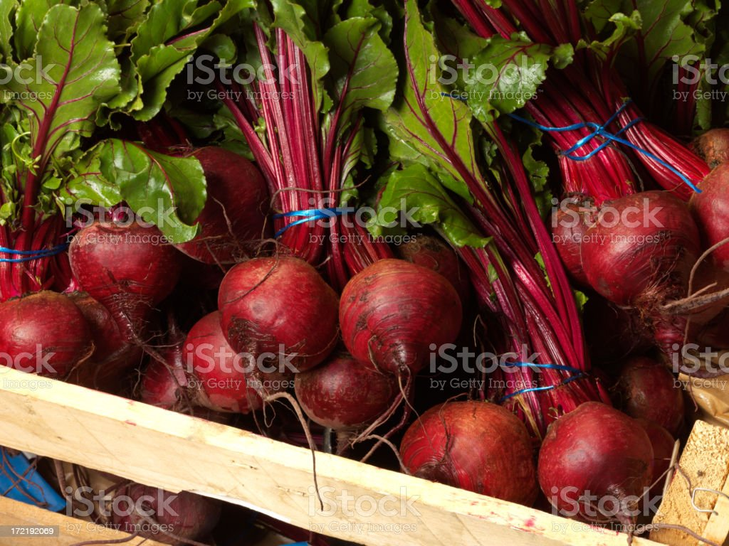 Red beet roots bundled in a wood crate royalty-free stock photo