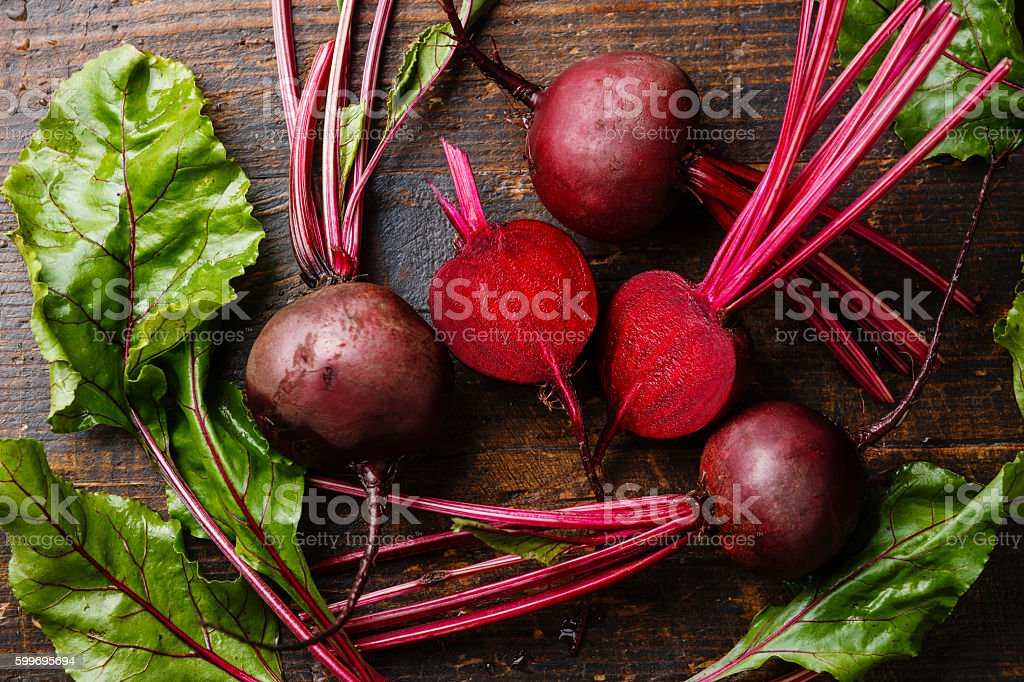 Red Beetroot with green leaves stock photo