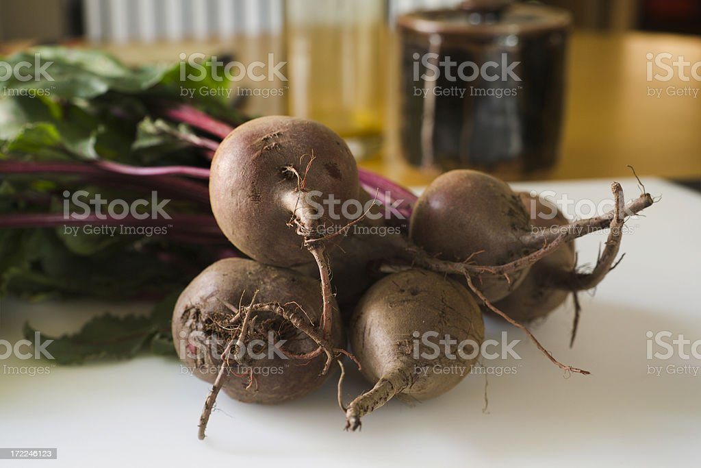 Red Beets on Cutting Board royalty-free stock photo