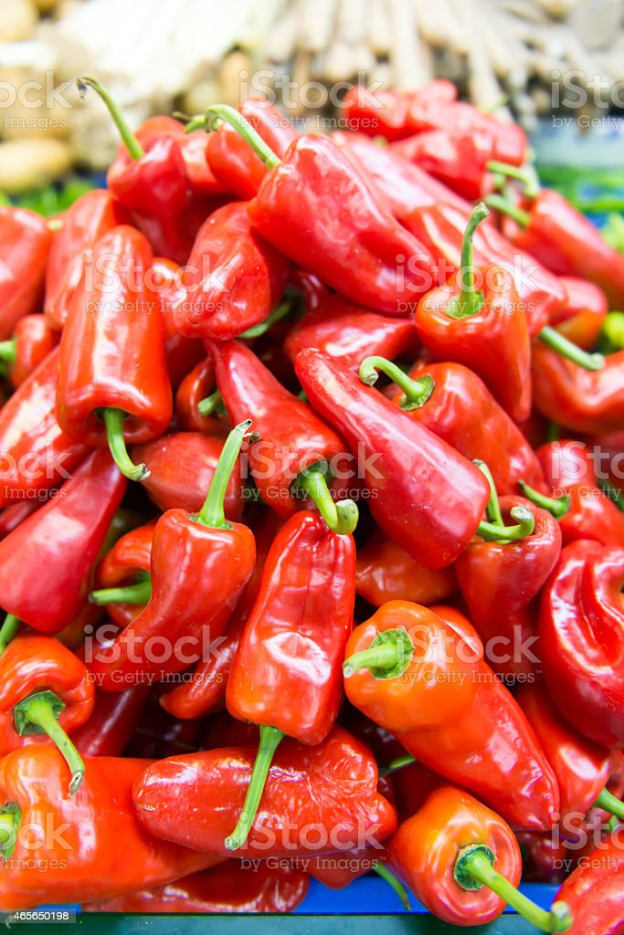 Red bell peppers at the local farmer's market. stock photo