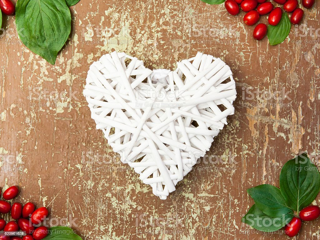 Red berries and white heart shape stock photo