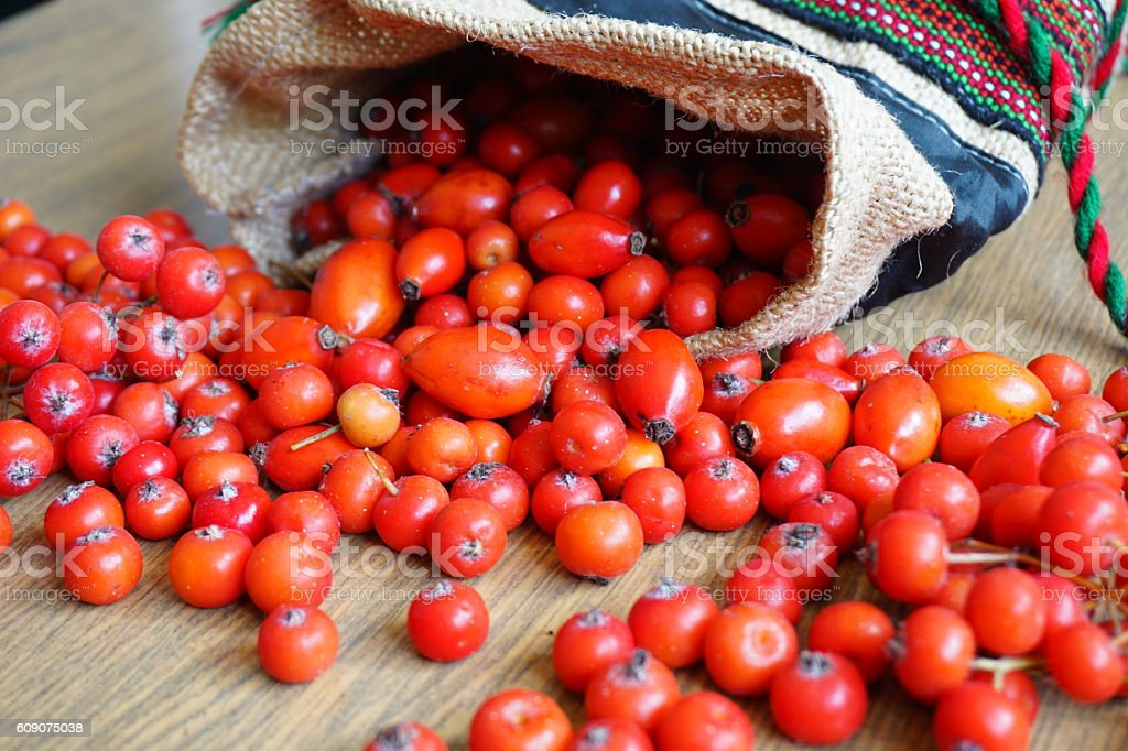 Red berries of hawthorn on a wooden table. Hello, Autumn! stock photo
