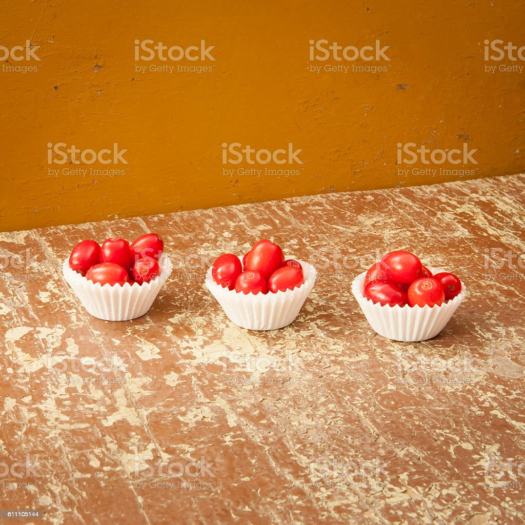 Red berries on a rustic wooden table stock photo