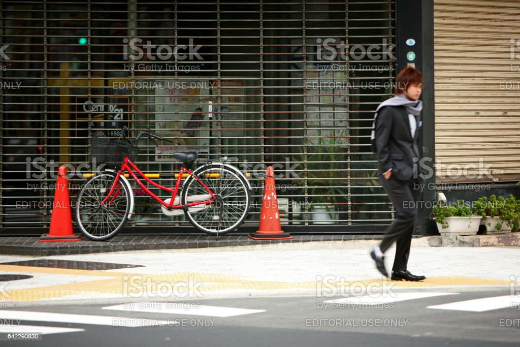 Red bicycle and the young Japanese dandy stock photo