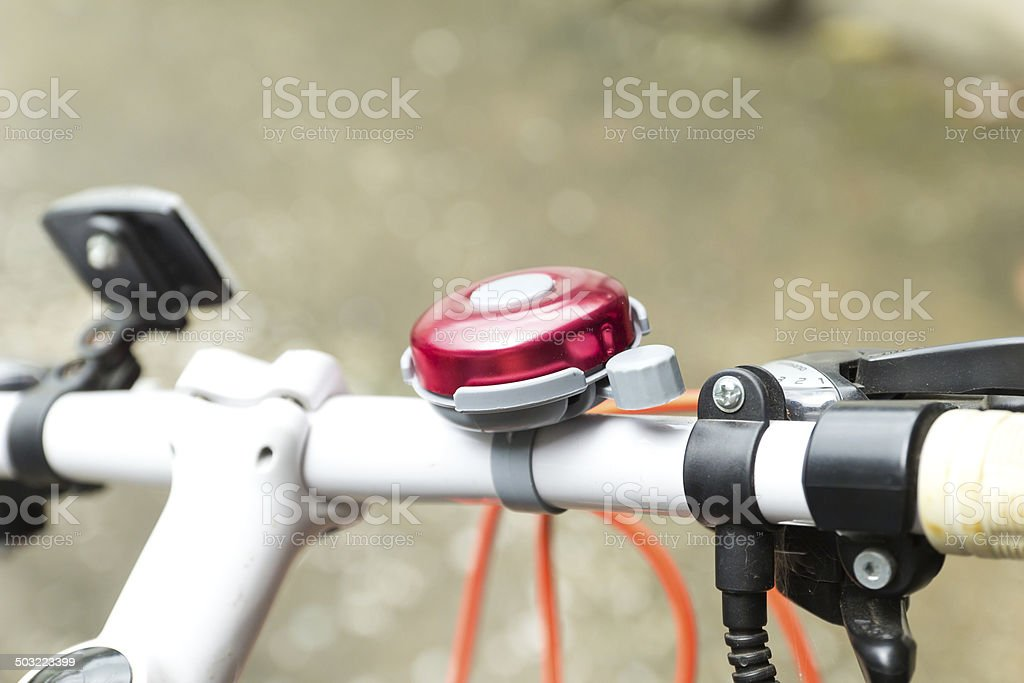 red bicycle bell stock photo