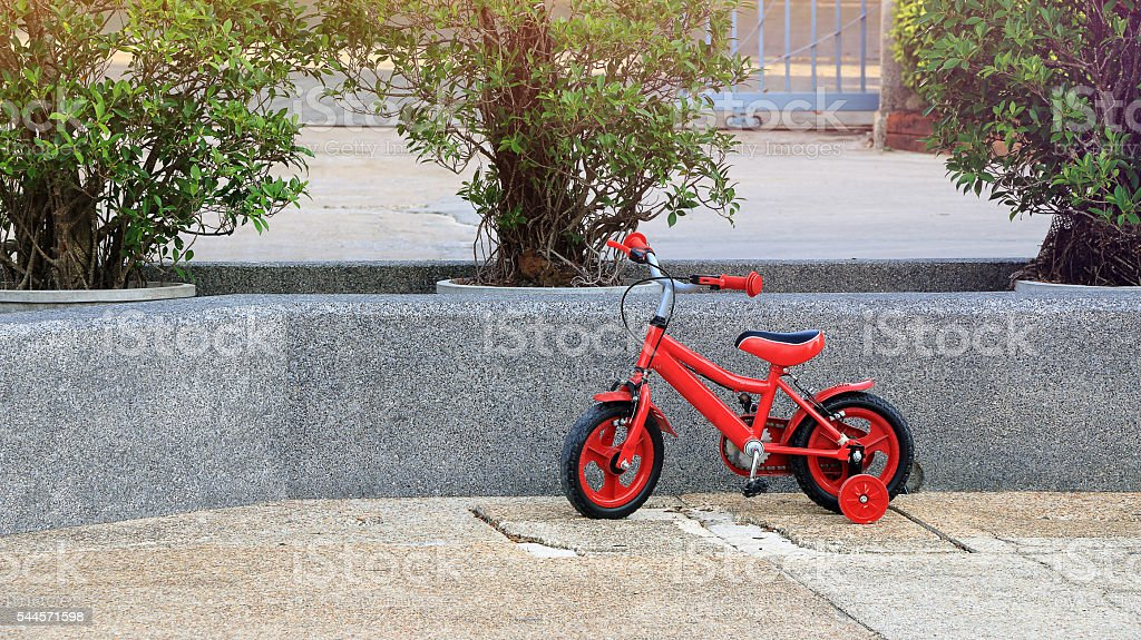 red bicycle for children stock photo