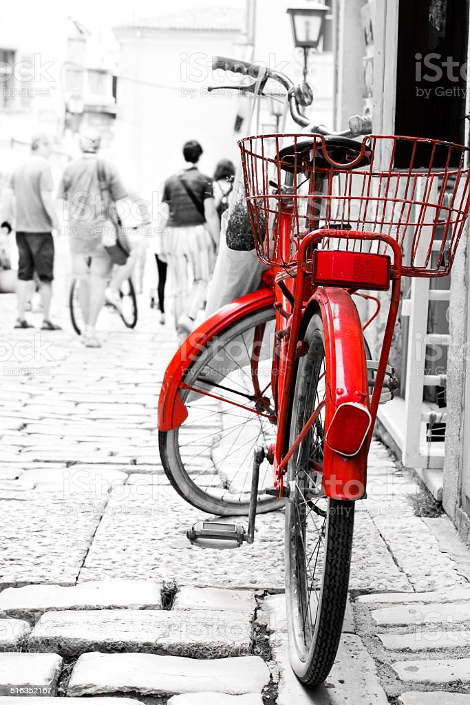Red bike parked at front of the building. stock photo