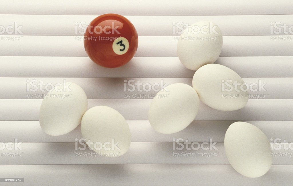 red billiard ball white eggs stock photo