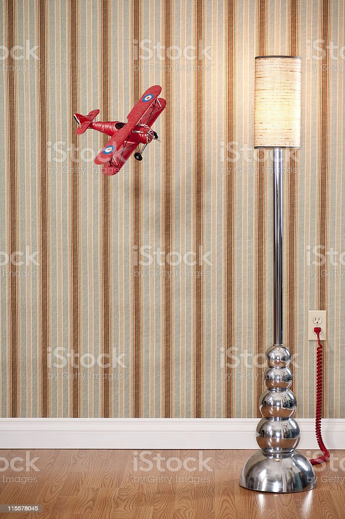 Red Biplane FLying In Empty Room royalty-free stock photo