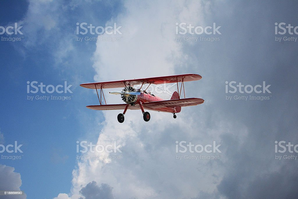 Red Bi-Plane on Dramatic Sky stock photo