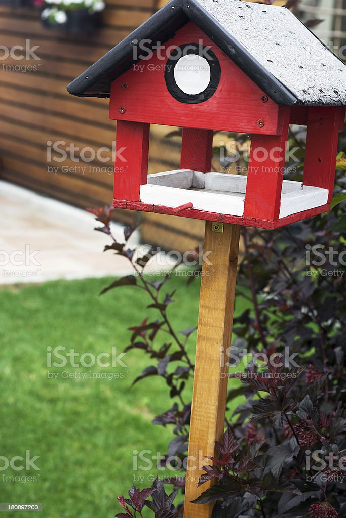 Red bird house royalty-free stock photo