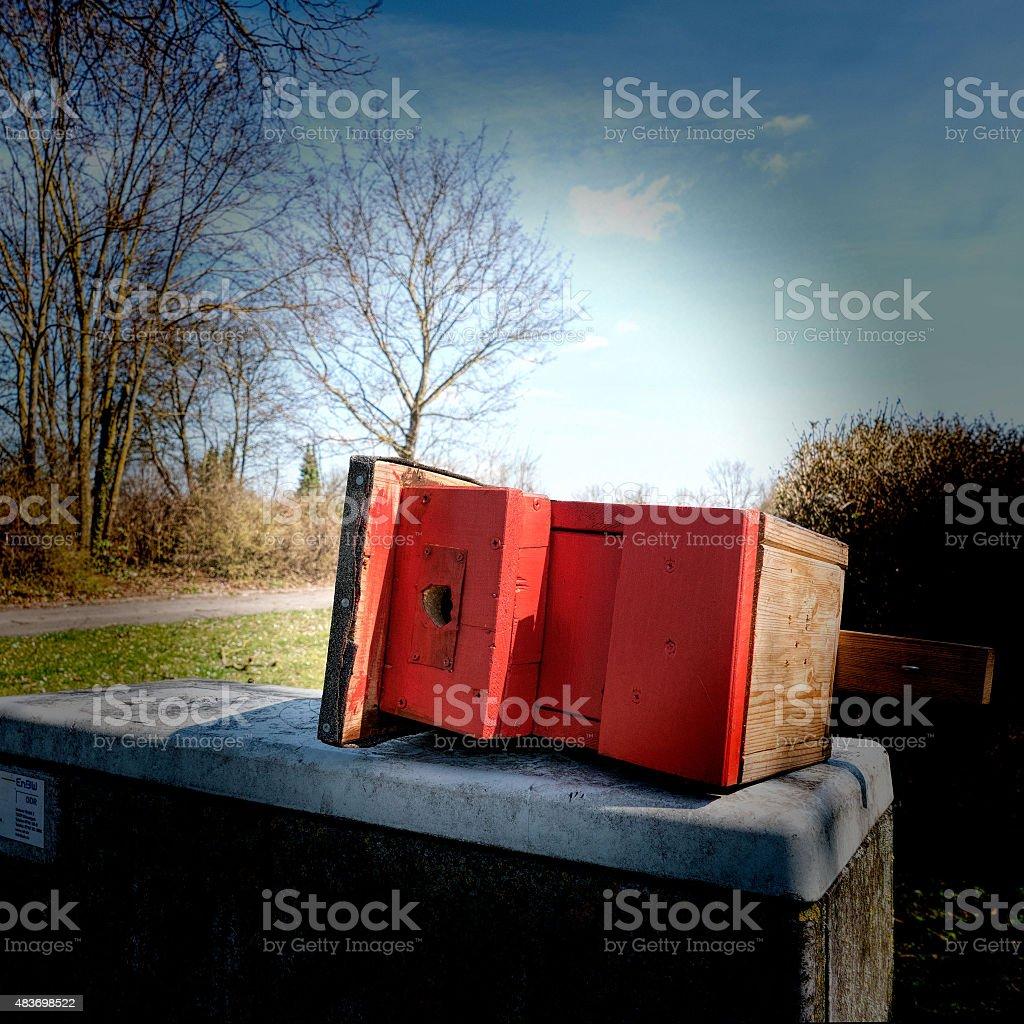 Red birdhouse overturned stock photo