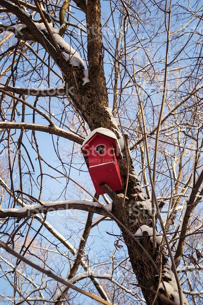Red birdhouse stock photo