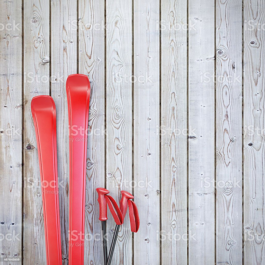 red blank skis on wooden planks wall stock photo