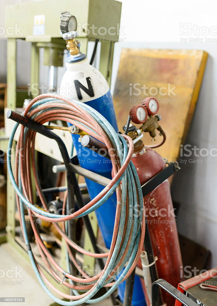 Red, blue and white oxygene gas bottles stock photo