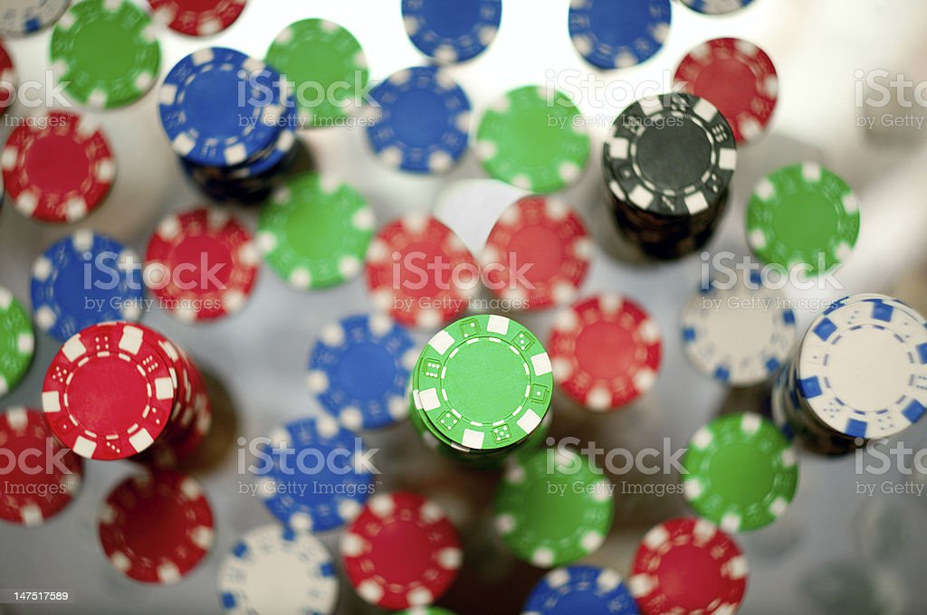Red, blue, green and black casino tokens royalty-free stock photo