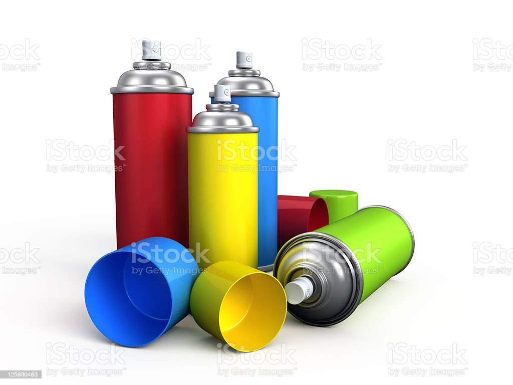Red, blue, green and yellow cans of spray paint stock photo