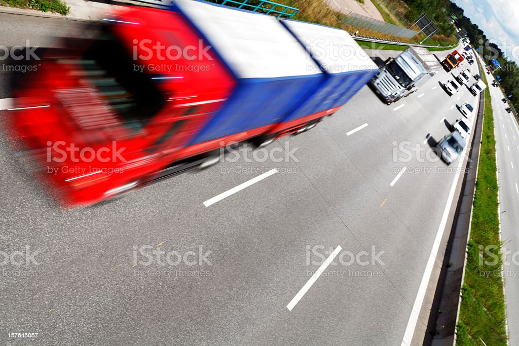 red blurred motion truck on the freeway royalty-free stock photo