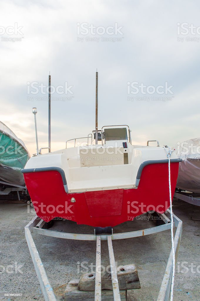 Red Boat on a Tugboat stock photo