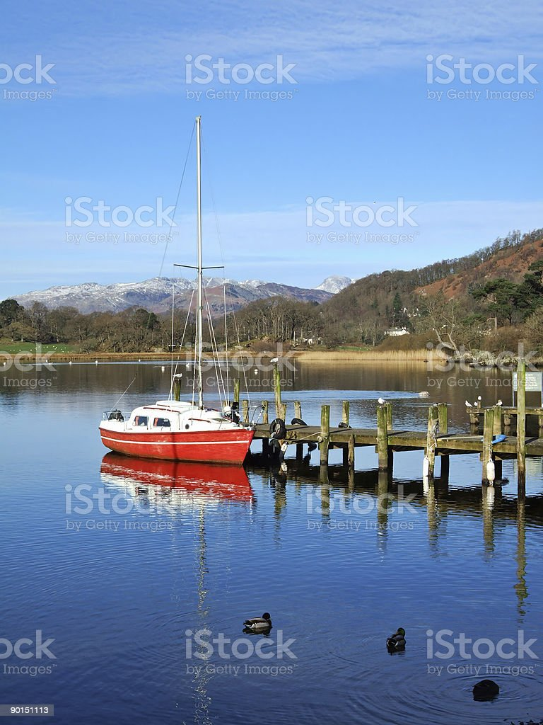Red boat on Windermere stock photo