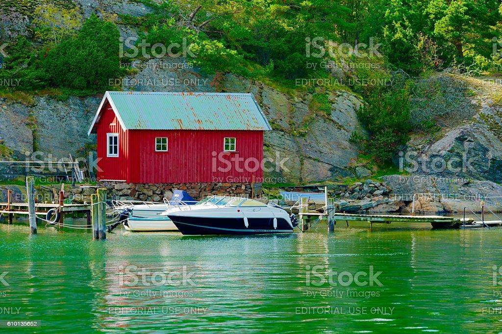 Red boathouse stock photo