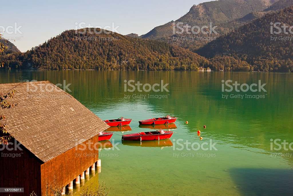 red boats on Wolfgangsee lake in Austria stock photo