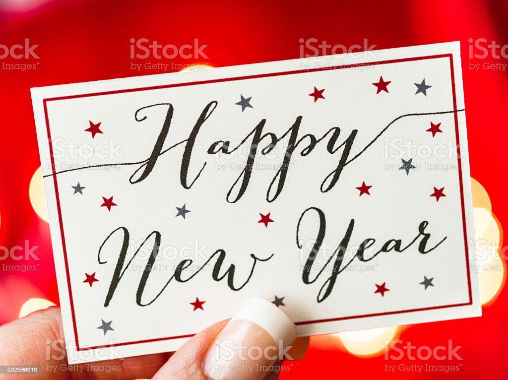 Red bokeh background with Happy New Year message stock photo