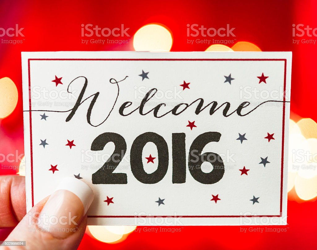 Red bokeh background with Welcome 2016 message stock photo