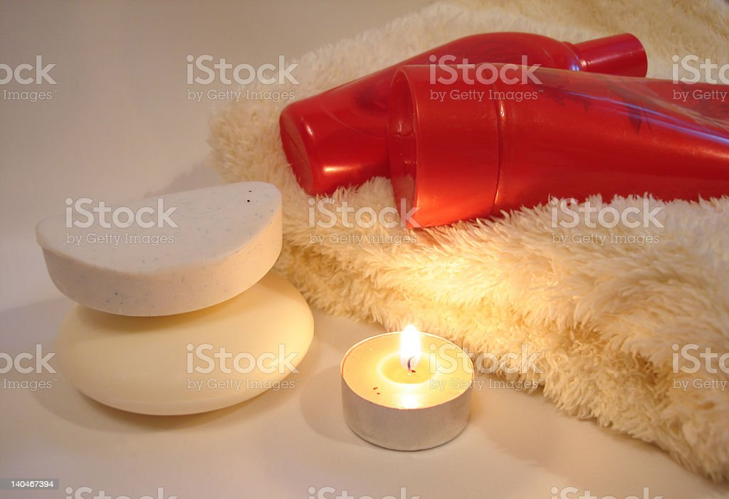 Red bottles of shower gel with soap and towel royalty-free stock photo