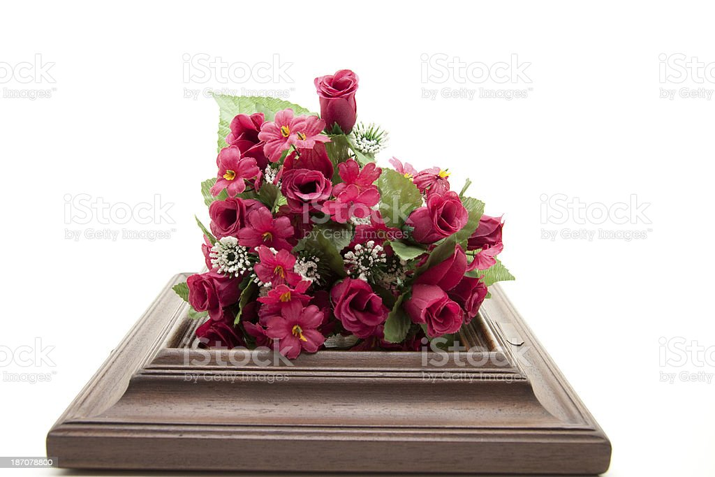 Red bouquet on wooden frame stock photo