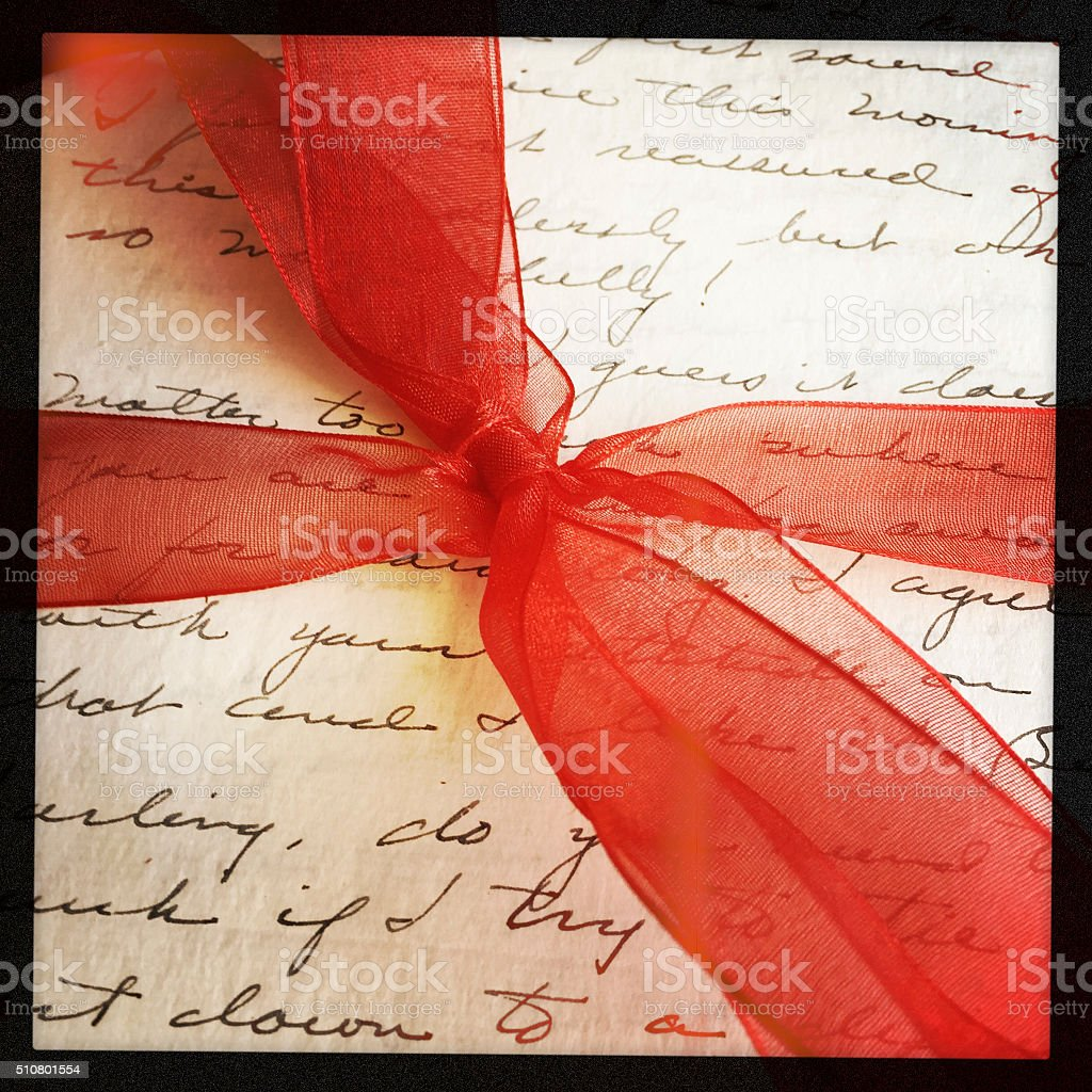 Red Bow around Old Letter stock photo