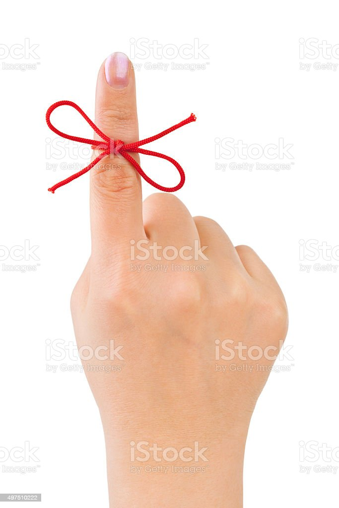 Red bow on finger stock photo