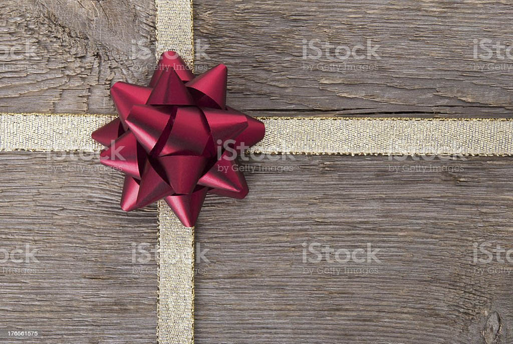 red bow on golden ribbon stock photo