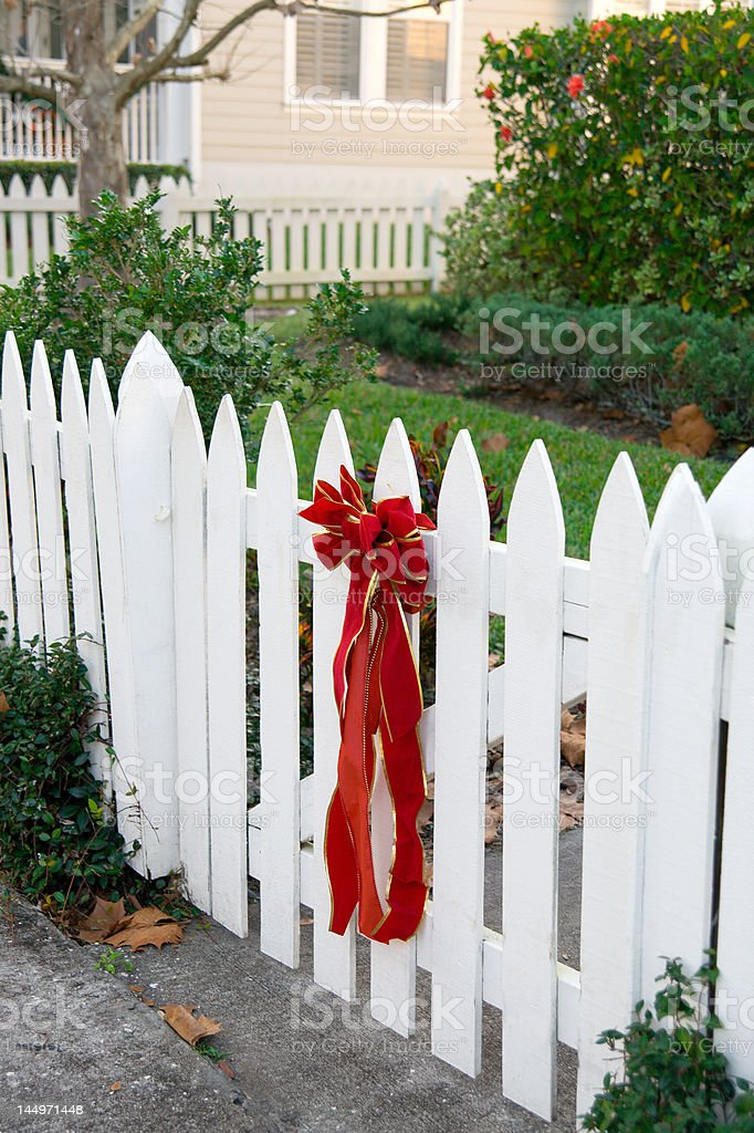 Red Bow on Picket Fence royalty-free stock photo