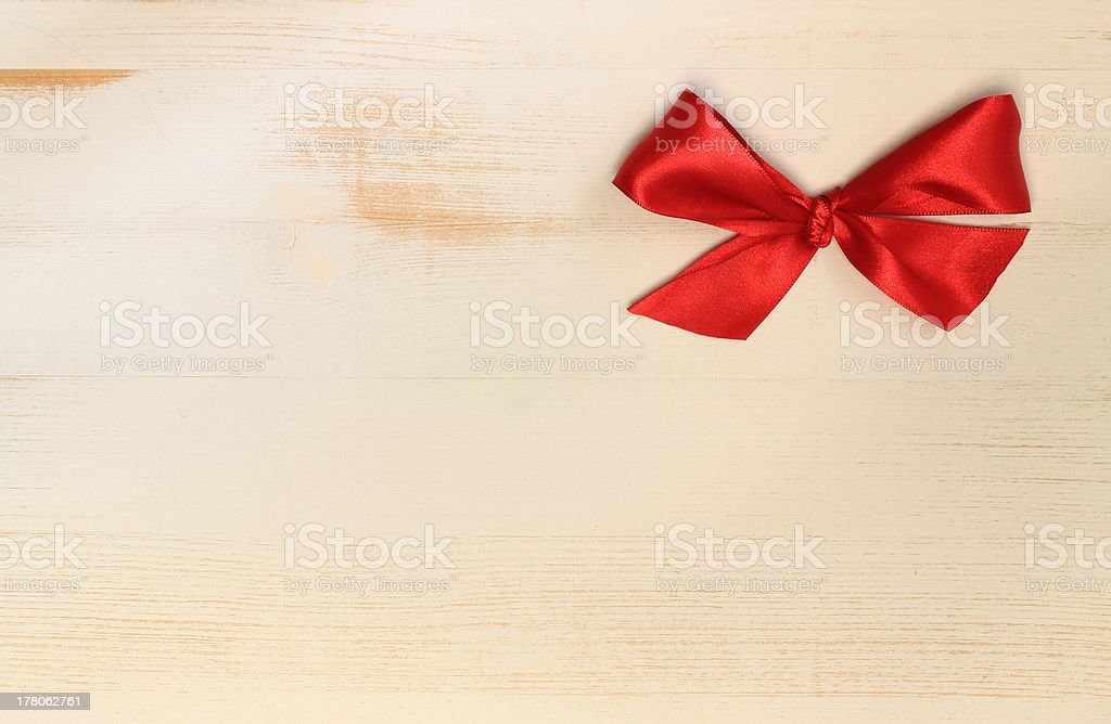 red bow on wooden background stock photo