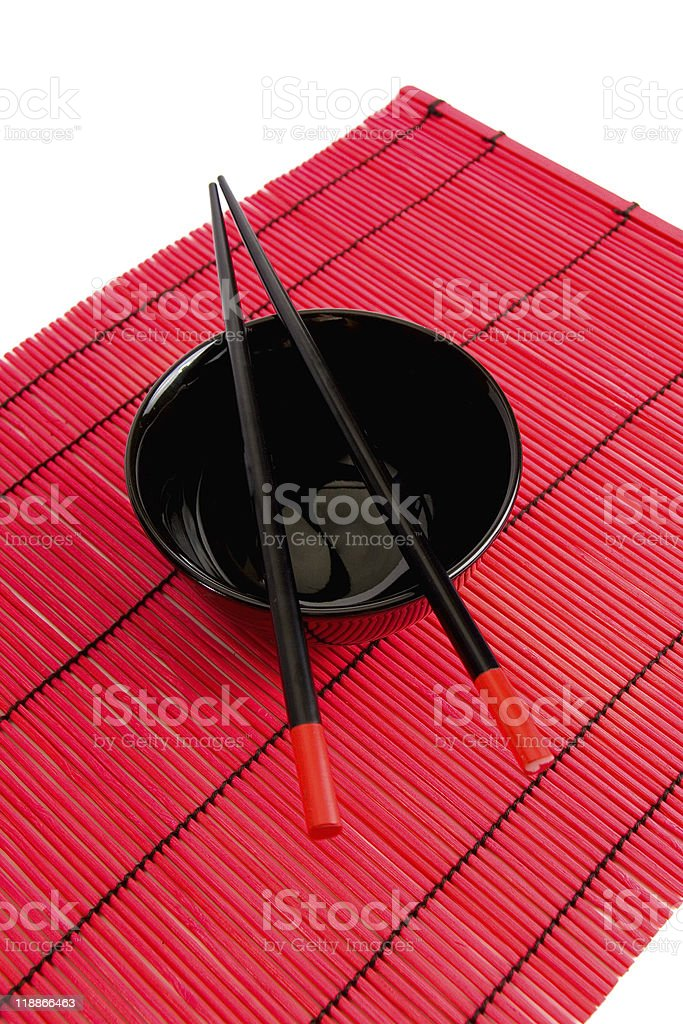 Red bowl and chopsticks royalty-free stock photo