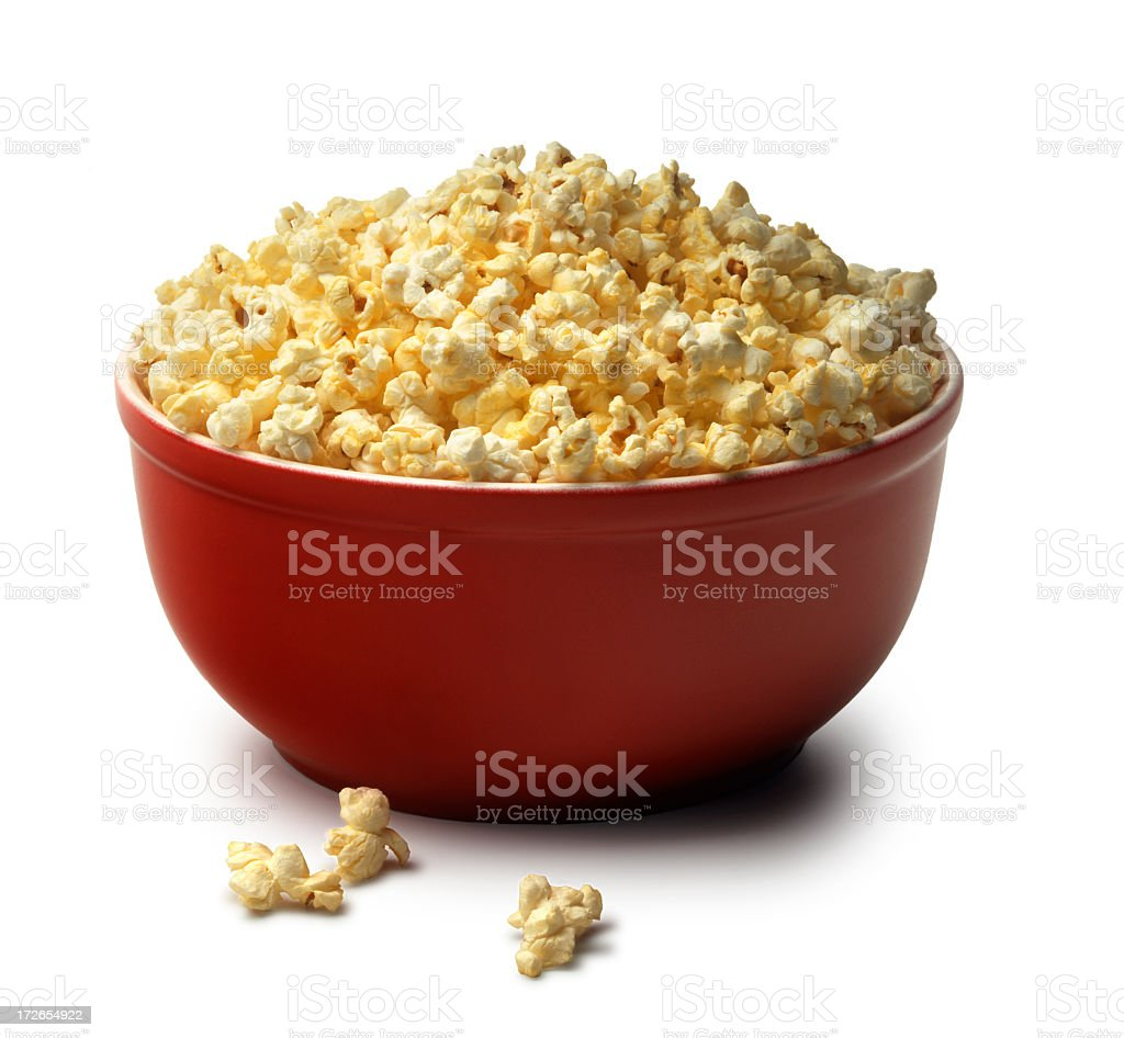 Red bowl of popcorn on a white background stock photo