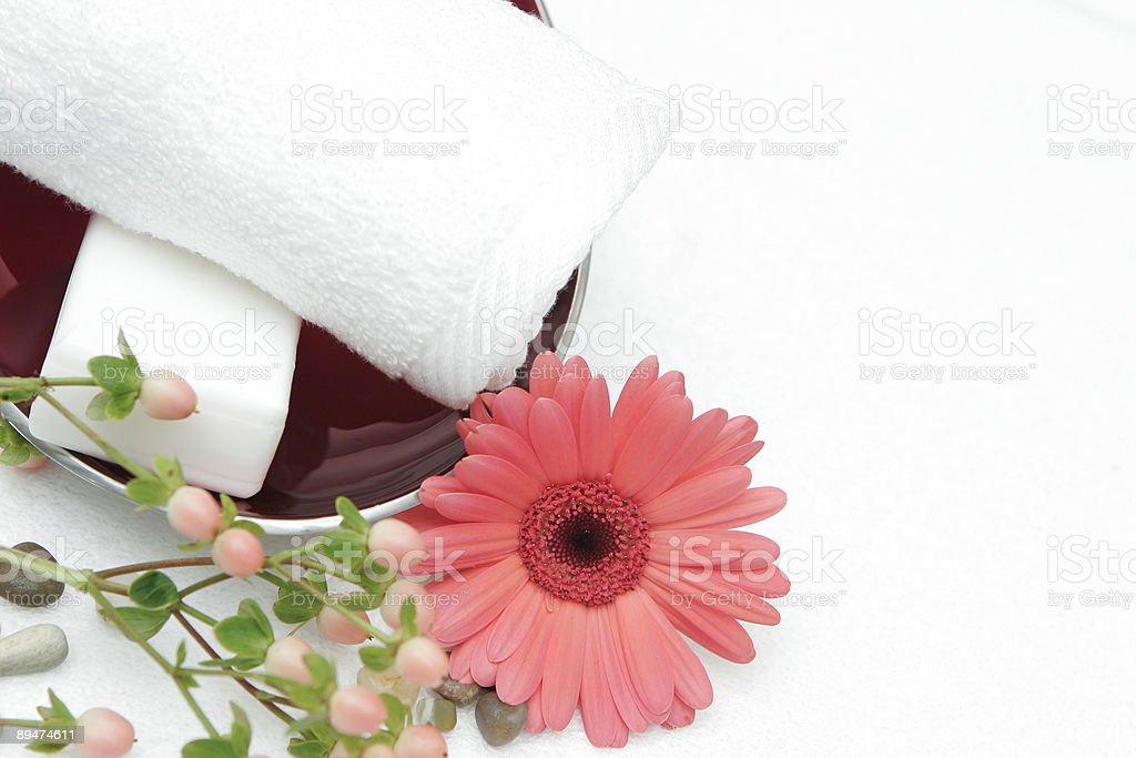red bowl with towel and flowers royalty-free stock photo