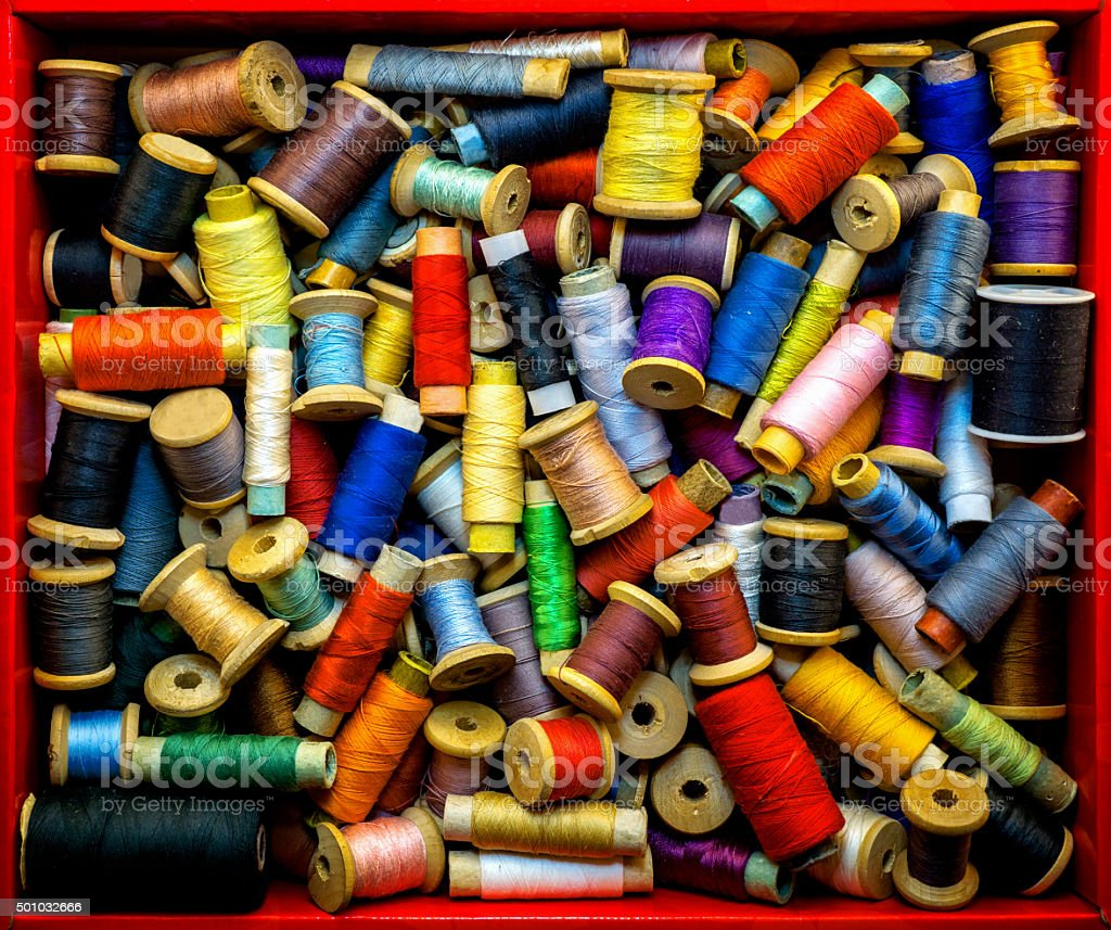 Red box with colored high contrasted threads for sewing stock photo