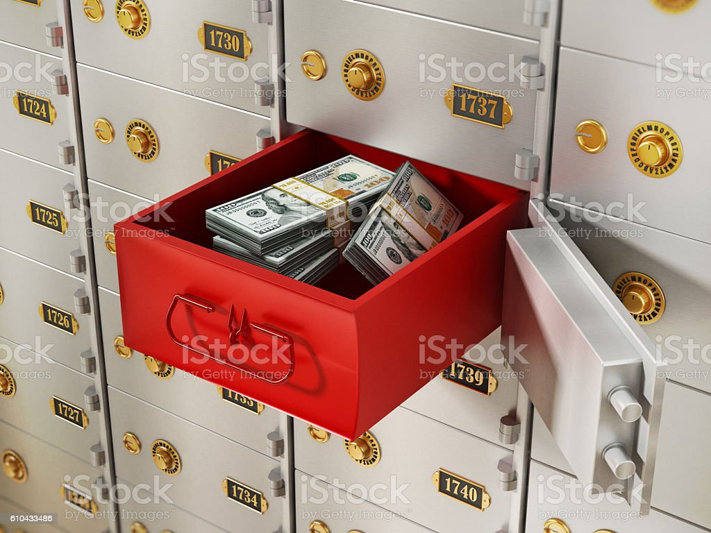 Red box with money lots behind open safety deposit box stock photo